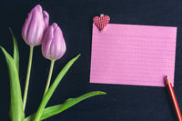 Tulips and paper note with a heart