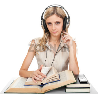 Student with books and headphones.