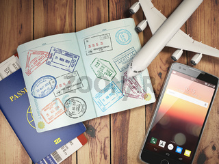 Travel and tourism concept. Passport with visas and boarding passes, airplane and mobile on the wood table.