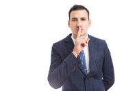 Sales man or broker touching lips as shush gesture