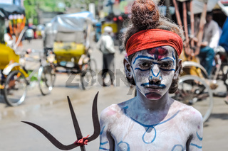 Boy with pitchfork in Assam