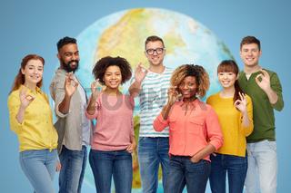 international group of happy people showing ok