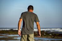 Man on Beach by the rocks