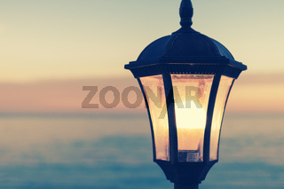 Vintage street lamp on the background of the sea