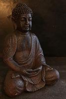 Buddha portrait isolated on a dark ground