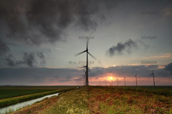 windmill turbines at sunset