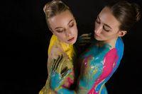 Two nude women with bodyart high angle shot