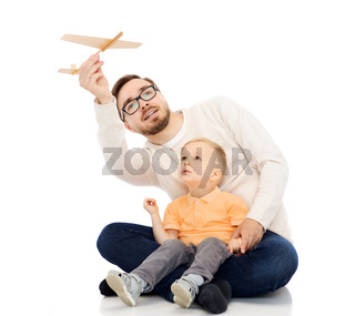 father and little son playing with toy airplane