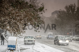 Heavy snowfall on the streets in Tabriz