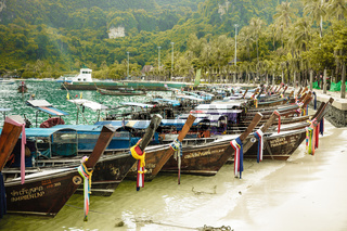 Colorful fishermens boats on the beach in Thailand province