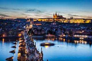 Charles Bridge on Vltava river in Prague, Czech Republic at late sunset, night. Prague Castle
