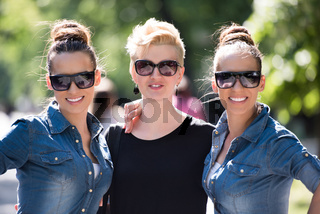 portrait of three young beautiful woman with sunglasses