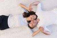 handsome couple lying on floor
