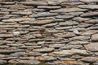 Natural stone wall of a mountain hut