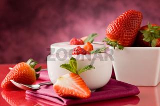 Strawberry yogurt with mint leaf