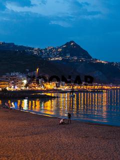 urban beach in Giardini Naxos town in summer night