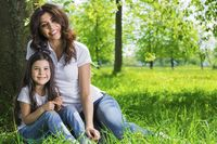 Young mother and daughter in park