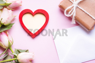 Red wooden heart and roses