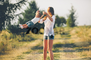 mother and daughter on a rural road