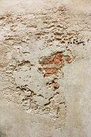 wall with cracks and bricks