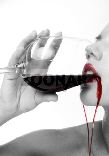 portrait of brunette girl drinking red wine