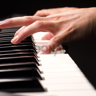 Playing piano close up