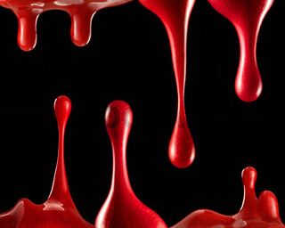Red paint on black background