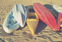 canoe boats and kayaks on beach
