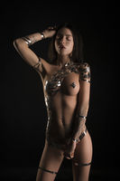 Naked slim girl her body covered with gold tape