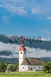 Cerkev in Bitnje, Slovenia at misty morning