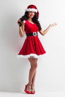 Christmas girl holding something