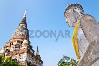 Buddha statue and ancient pagoda