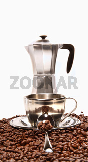 Cups resting on coffee beans with percolator