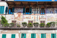 medieval frescoes of facade urban house in Verona