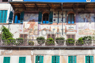 medieval frescoes of facade urban house in Verona