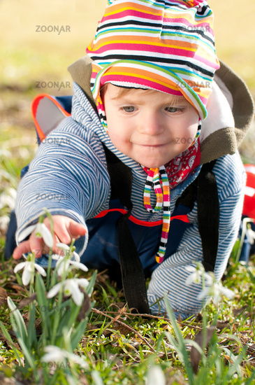 Cute little girl crawls and discover the world in