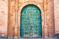 Beautiful Turquoise wooden gate to a church in Cusco