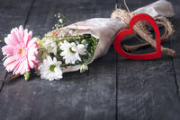 Bouquet of flowers and a red heart