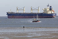 Freight ship in the Wadden Sea, Cuxhaven, Lower Saxony, Germany, Europe
