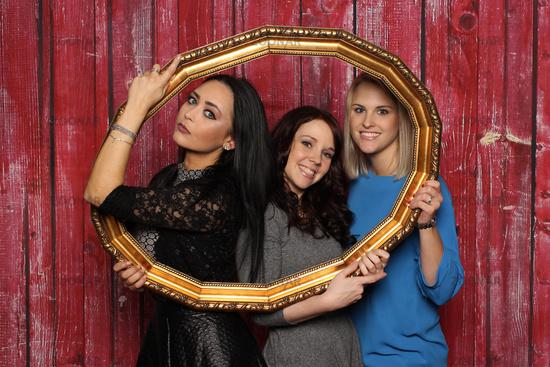3 girls look through a golden frame