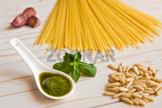 Closeup of pesto genovese sauce and linguine pasta, pine nuts and garlic
