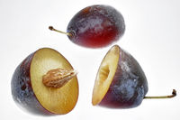 whole and halved plums to indemnify.
