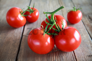 Sweet tomatoes isolated on wooden background
