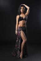 Young brunette wearing Easten dance dress shot