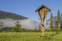 Idyllic wooden cross in the Jachenau