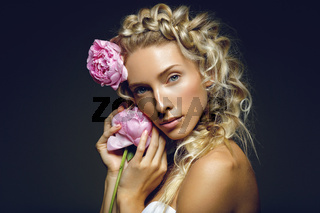 Beautiful girl with peony flower