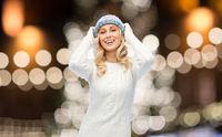happy woman over christmas lights