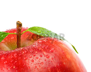Fresh yellow apple with leaf. Isolated on white ba