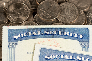 USA Social security cards laid on quarter coins