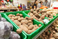 Potatoes on supermarket vegetable shelf